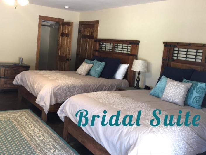 [Image: Our luxurious Bridal Suite has two plush beds with ample seating and more! ]