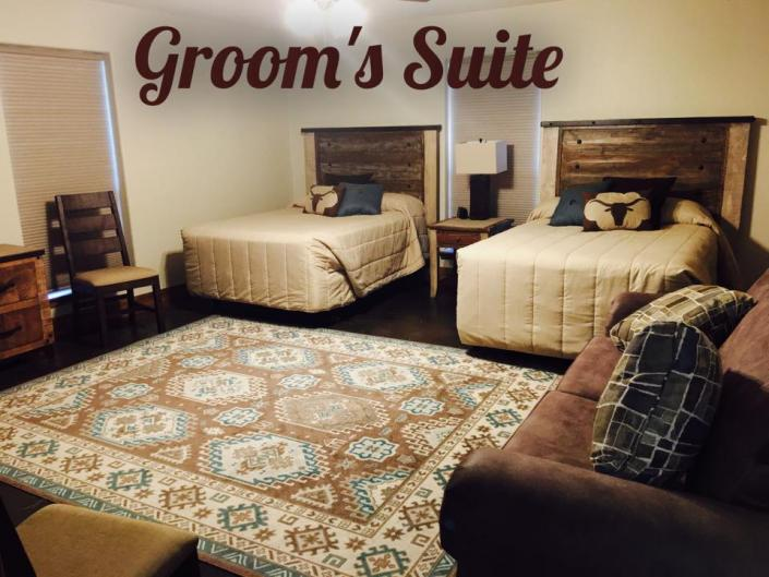 Our Groom's Suites has plenty of space along with two full beds and a lovely seating area!