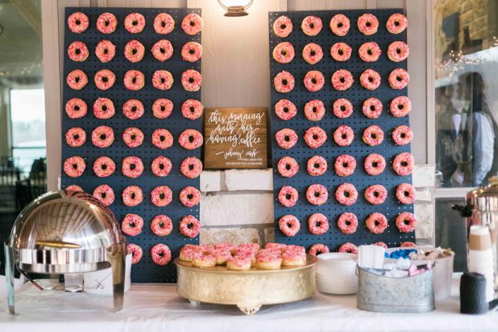 We just love how this couple chose an adorable donut display for their wedding reception!
