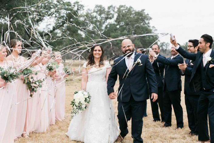 Bride and groom exit walk with fun streamers!